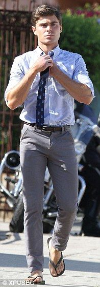 Zac Efron styles his suit with flip flops