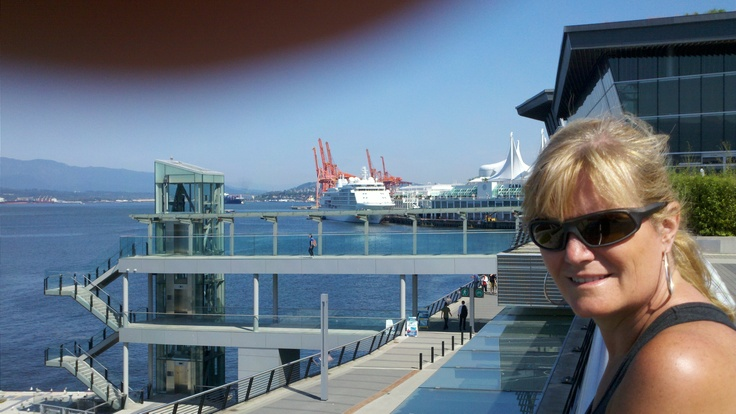 My Beautiful Wife in front of Vancouver Convention Center looking toward Canada Place and North Shore Mountains in the background - damn finger!
