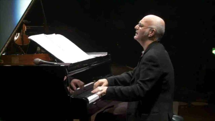 Ludovico Einaudi  On donut headphones, any time or place...a master of his art, inspiring, calming, focusing, transports me,   One day I will go to a concert, that is going to be a major WOW moment.