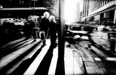 Photo by Trent Parke. I love the really long shadows going into the corner of the photo. Great angle from below looking up, nice contrat with the sun and shadows, I like that the couples faces are visible as well.