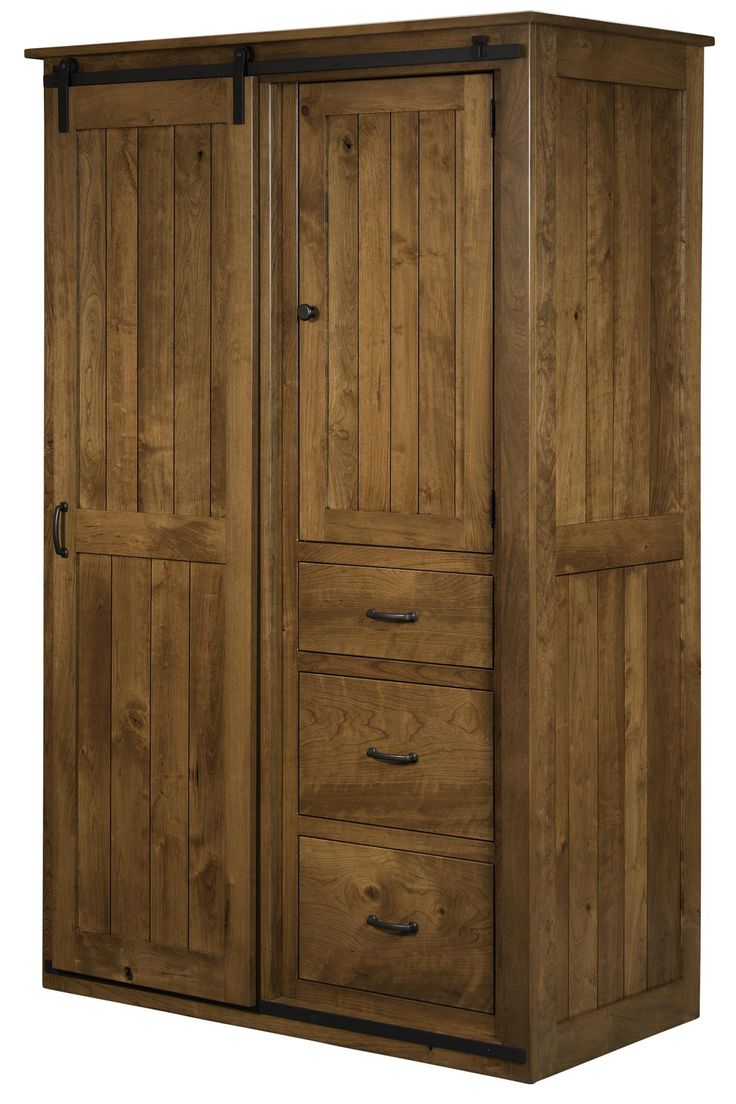 Sliding Barn Door Wardrobe Cabinet There's a cozy warmth to the Sliding Barn Door Wardrobe Cabinet. Behind the barn door is the perfect place to store warm fall sweaters.
