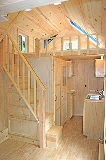 Tiny House with Stairs: country cottage, is 8'x17' with a fold up deck. Powered by solar. This house sold for $50k
