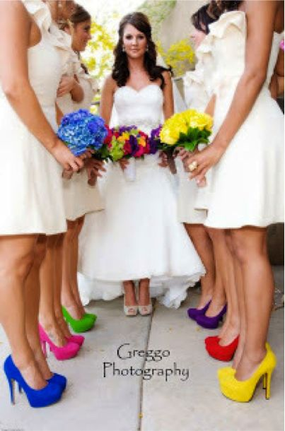 Different colored bridesmaid shoes and flowers. Bride have a mix of all