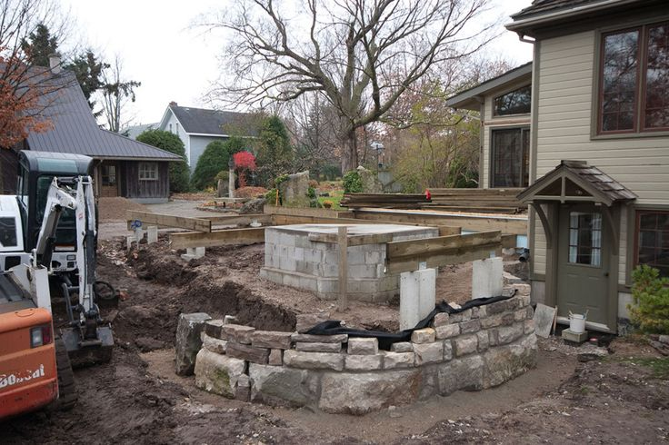 New foundations emerge with the beginnings of a fireplace and garden wall.