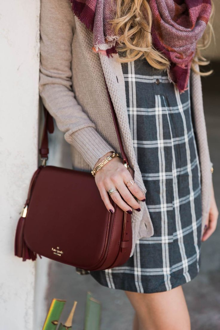 styling a plaid dress with a cozy sweater and burgundy bag
