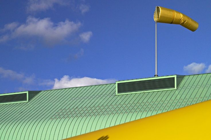Plastic grass could cover buildings to produce energy from wind | New Scientist
