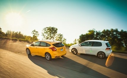 2013 #Ford #Focus ST vs. 2012 #Volkswagen #GTI - Slot-Car Skirmish: The Ford Focus ST lines up against the original hot hatchback, the Volkswagen GTI.