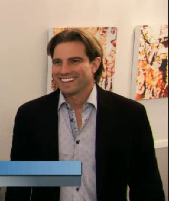 "Art: Sarah Martin (behind Scott McG)  HGTV, ""Income Properties"" Season 7, Ep.5"