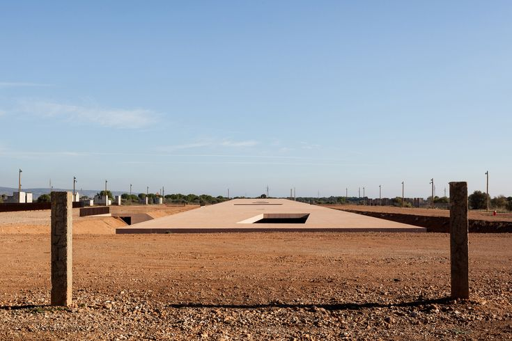 Rudy Ricciotti sinks Rivesaltes Memorial Museum in ochre furrow at former French military camp