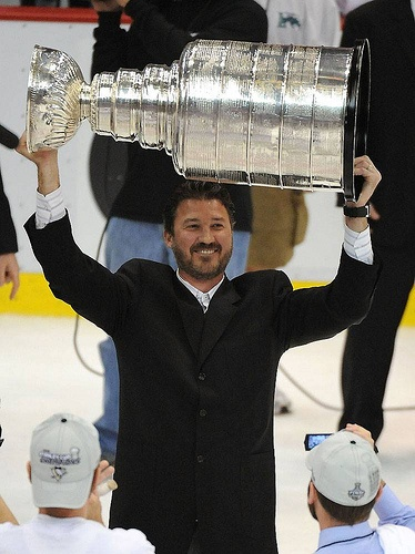 Mario Lemieux raised the Stanley Cup once again as the principal owner of the Pittsburgh Penguins in 2009.