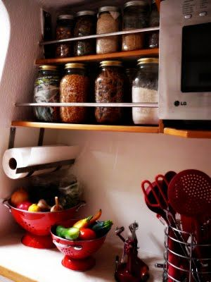 """galley storage - I was trying to describe this EXACT idea to the ship's carpenter recently. Then I got all embarrassed when I got to """"mason jars,"""" and told him to never mind."""