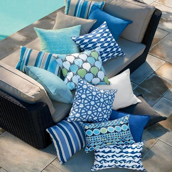 Brighten up your pool deck with colorful throw pillows with outdoor fabric from Fabric.com - Blue, turquoise and cream outdoor sunbrella throw pillows