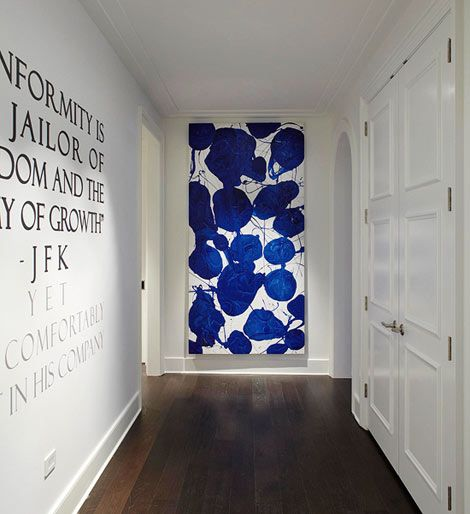 If you've got it - flaunt it in this: Bold Blue Entryway The entryway into designer Julia Wong's sky-high apartment for the Ritz-Carlton Showcase in Chicago makes a bold first impression. A large painting by Bradford Stewart hangs at the end of the narrow entry, packing a punch of color against the hallway's crisp white walls.