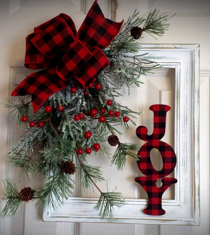 Decoupage some fabric over a sign to make your own red and black JOY wreath attachment, then remove the sign for all winter long decoration
