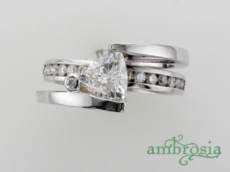 Best Custom designed engagement ring with a Trillion cut diamond This modern and contemporary white gold