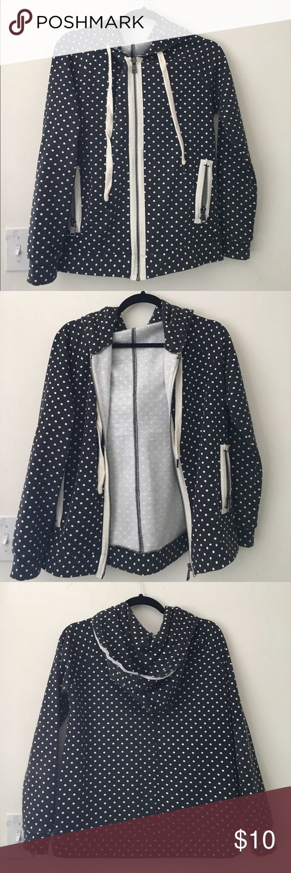 Black and White Polka Dot Zip-up Hoodie Thick polka dotted jacket, great for fall and winter. Has a hood and super long draw strings. Pockets zip up. Lined with fleece. Worn gently, still excellent condition. The white colour is faded as design, not wear. Jackets & Coats