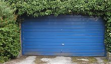 An older typical version of an overhead garage door would be build with one-piece panel, although the newer versions of overhead garage doors this days build from several panels hinged together that roll along a system of tracks guided by rollers.