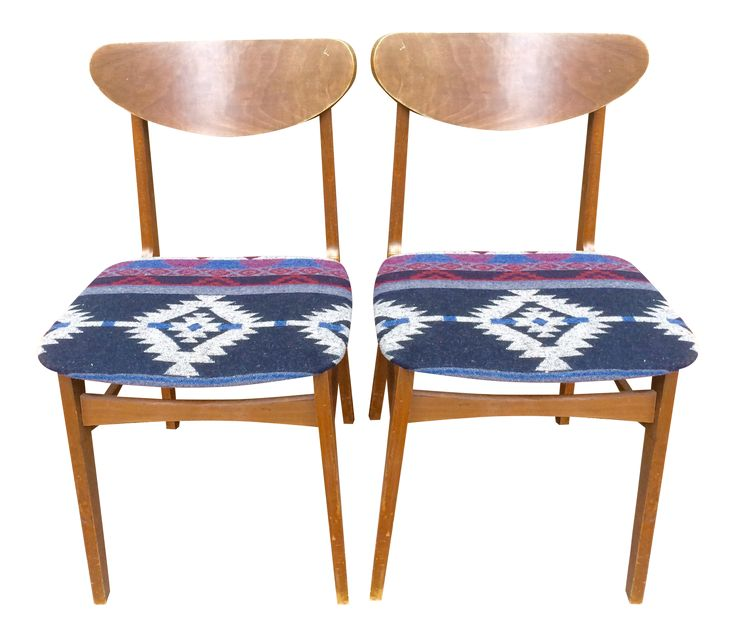 Pair of Mid Century Reupholstered Dining Chairs with southwestern fabric.   We have taken a pair of mid century dining chairs and Reupholstered them with a fun southwestern Pendleton style fabric. The pair would be perfect in a small apartment setting or to act as extra seating in your dining room. Could also be used for staging. The chairs have age and slight structural ware. One of the chairs wobbles but is easily repairable, please see photos since we have priced accordingly.