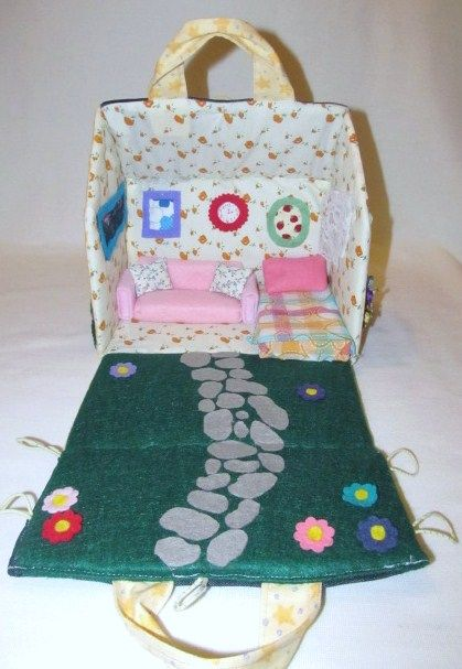 This is a handmade one of a kind fabric house. It is 8 inches high, 9 inches in length and the width is 5 inches. It opens up to a room with a couch and a bed and a fold out garden. The house is made from a pattern found at: http://uklassinus.blogspot.co.uk/2008/08/fabric-dollhouse-tutorial.html  Also includes a Waldorf style mini fairy doll and a hand sewn felt unicorn. See other pictures. £35.00 plus shipping