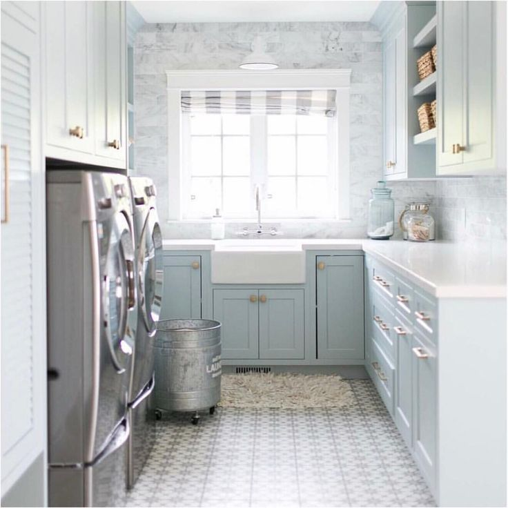 Soft pastel cement tile in laundry