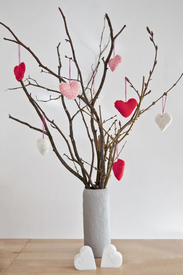 If you have some knowledge on knitting, you can make these cute little hearts that you can hang on a vase of twigs you've found on your yard.