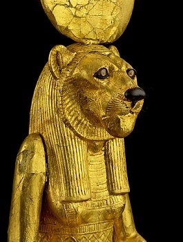 The goddess Sekhmet, daughter of Re, wife of Ptah and mother of Nefertem is associated with the lioness and takes its attributes as dangerous power but also maternal instinct. The figure is gessoed and gilded wood with the body of a woman and the head of a lioness. On her head is a sun disk. Located in Egyptian Museum, Cairo. | Located in: Egyptian Museum, Cairo.