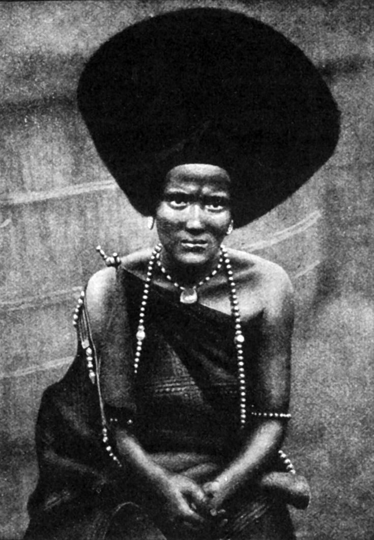 "Africa | ""Fuzzy Wuzzi woman of the west; her way of gumming her hair over a great light framework connects her with the Beja Nile race and the Baggara Fuzzy Wuzzies who were broken at Omdurman"" 