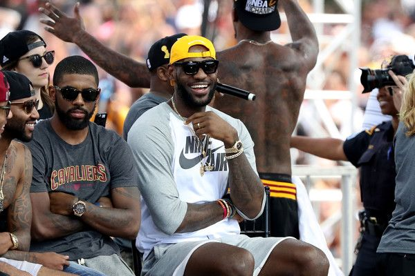 LeBron James Photos - Kyrie Irving #2 and LeBron James #23 of the Cleveland Cavaliers look on from stage during the Cleveland Cavaliers 2016 NBA Championship victory parade and rally on June 22, 2016 in Cleveland, Ohio. - Cleveland Cavaliers Victory Parade And Rally