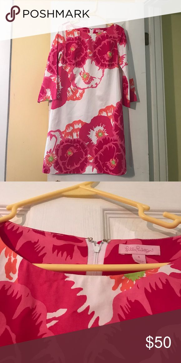 Lilly Pulitzer dress Lilly Pulitzer Floral dress with sleeves about 3/4 sleeves if you have longer arms I have short arms so they are almost long sleeves on me. This dress is machine wash cold. Lilly Pulitzer Dresses Midi