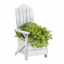 Let your plant sit in this relaxing planter! This wooden Adirondack chair is finished in white with a weathered look. The seat fits a standard planter, and this