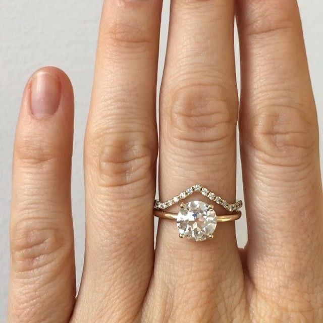 Simple and pretty. Custom engagement ring featuring a 1.94 carat old European cut white diamond, prong set in 14k yellow gold. I'd like to see it in white gold...