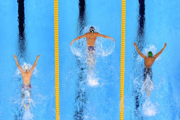 Michael Phelps (C) of the United States leads Chad le Clos of South Africa (R) and Tamas Kenderesi (L) of Hungary in the Men's 200m Butterfly Final on Day 4 of the Rio 2016 Olympic Games at the Olympic Aquatics Stadium on August 9, 2016 in Rio de Janeiro, Brazil.