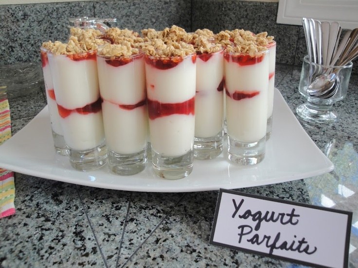 Yogurt parfaits -- piped in the yogurt and strawberry sauce then topped with granola