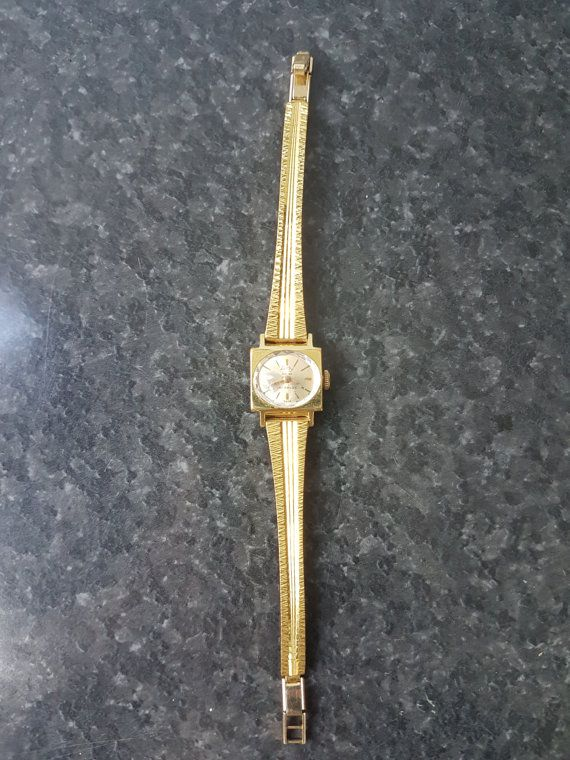http://www.arlywatch.com/   This is a unique Arly Watch Model. It has Gold Inscriptions on it. It is at least GOLD PLATED!  The watch is an antimagnetic watch and is in WORKING CONDITION.  You can see on teh website the wtaches go from 400 Euros to 3000 Euros.  This Model has 50 years old at least and is made of gold.   This watch is worth between 2000$ and 3500$  This is highly collectable and for rich people
