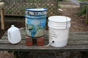 23 best images about gardening rain gutter grow system - Self watering 5 gallon bucket garden ...