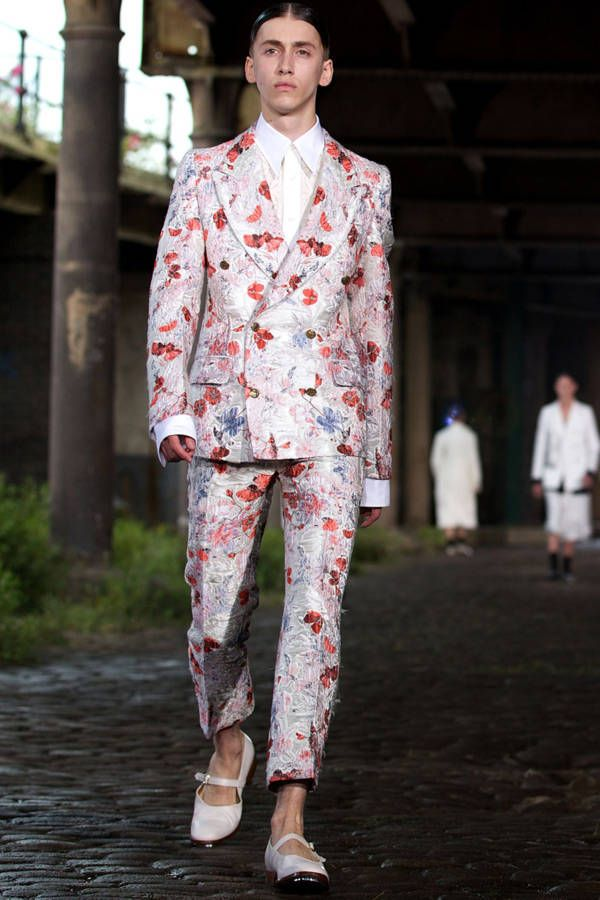 A model presents a creation by Alexander McQueen during the Spring/Summer 2014 London Collections: Men fashion event in London on June 17, 2013.