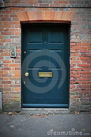 Front Door of a Red Brick House by 1000words, via Dreamstime
