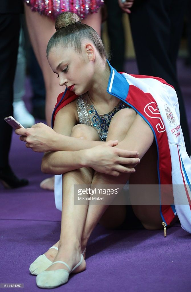 MOSCOW, RUSSIA. FEBRUARY 20, 2016. Aleksandra Soldatova of Russia using her smartphone during the Gazprom Champions Cup named after Alina Kabaeva, the first event of the 2016 Rhythmic Gymnastics Grand Prix Series. Mikhail Metzel/TASS