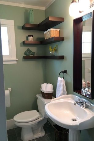 Traditional Powder Room With Wicker Baskets Stone Tile Floors Crown Molding Casement
