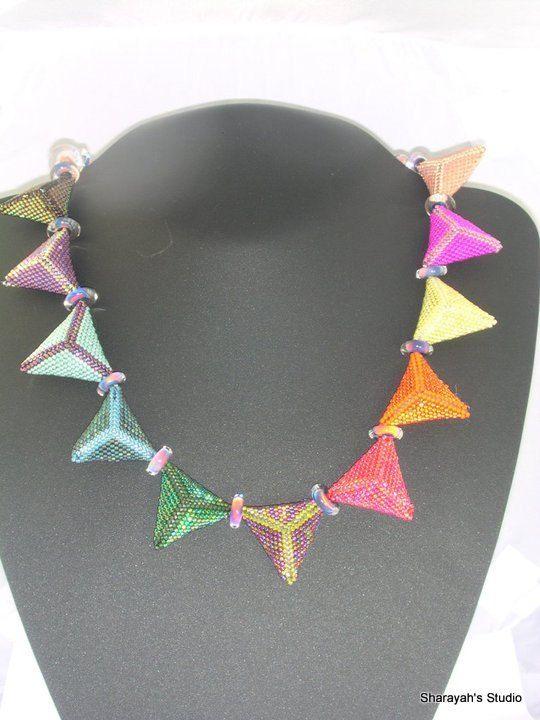 Geometric Rainbow  Peyote Stitched Triangles. Reserved by 4uidzne