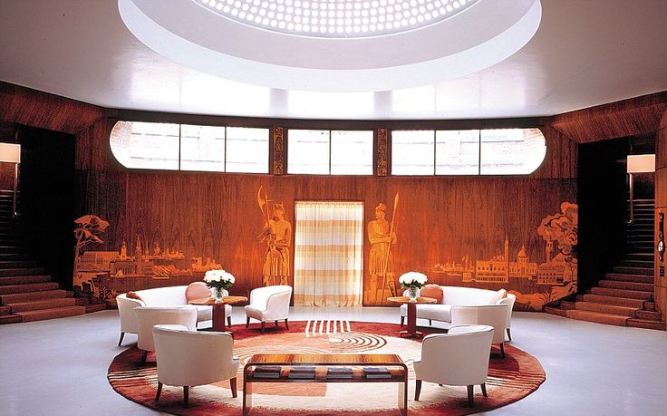 Entrance hall to Eltham Palace, with domed glass roof and curved wood-lined walls. 1933. Once the childhood home of Henry VIII, it was acquired by an American couple, (Cortauld) and rebuilt in an extravagant art deco style.
