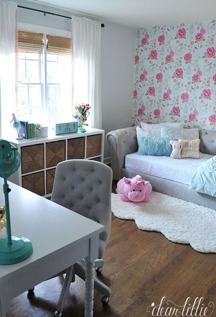 Fun accessories like this teal desk lamp and an aqua tool box full of her little toys and a pink stuffed unicorn all from HomeGoods help make this little girl's room with the tufted daybed and pink and blue wallpaper full of personality! (sponsored pin)