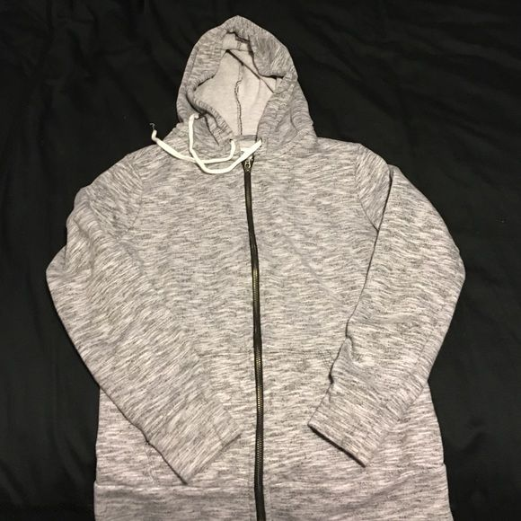 Old navy zip up hoodie Old navy gray and black zip up hoodie. Worn once. Women's size small. 66% cotton, 34% polyester Old Navy Tops Sweatshirts & Hoodies