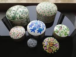 Lovely hand-painted boxes from Northern India are made of recycled newspaper. Tikau shop