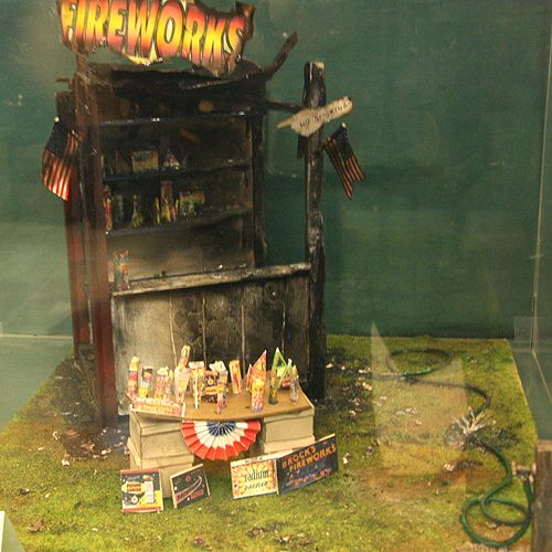 Dollhouses and Scenes From the Spring 2011 Seattle Dollhouse Miniature Show: Burnt out fireworks stand in miniature by Cindy Diamond