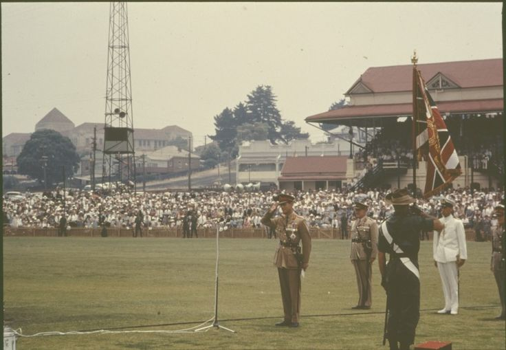 084995PD: Prince Philip presenting new colours at the Trooping the colour at the WACA, Perth, 25 November 1962. https://encore.slwa.wa.gov.au/iii/encore/record/C__Rb4683561