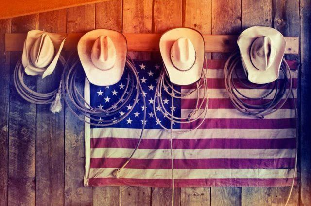 Cowboy hats, ropes, USA flag.