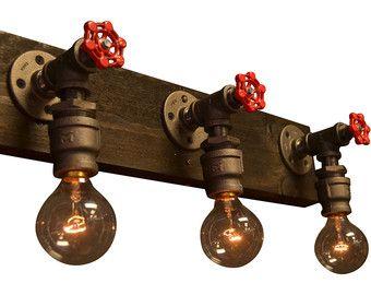 DESCRIPTION: Ne combinant à la fois de bois et de notre douille en acier sur mesure, il y a aucun lieu que cette lumière ne peut pas être utilisée. Nous avons utiliser un morceau de bois vieilli puis les tache de tache jacobin. Chaque pièce de bois est la même taille, mais tous sont en détresse différemment et chacun est unique. Cette lumière est conçue pour une installation facile et est livré avec les éléments nécessaires à joindre à votre coffret électrique  ~ TOUTES LES LUMIÈRES PEUVENT…