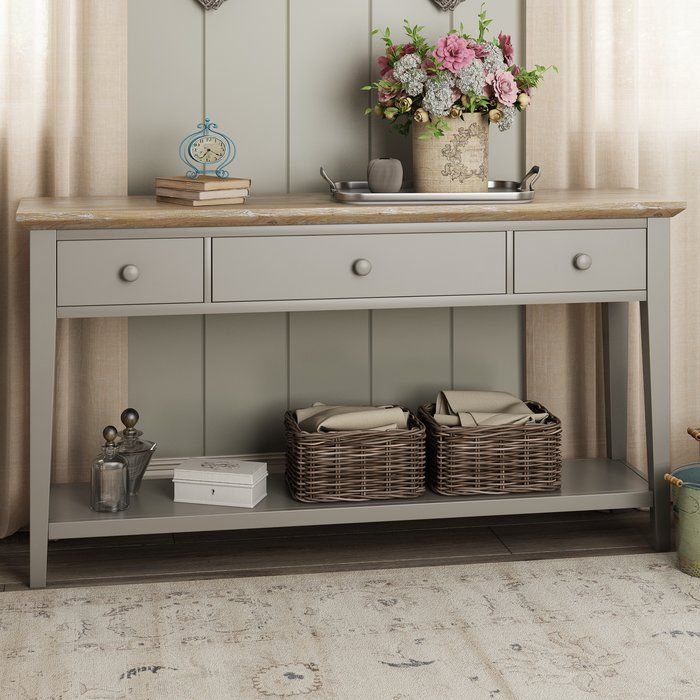 If you're always misplacing keys or never sure where to put the post, this console table is the perfect choice. Featuring three drawers and an underneath shelf, it's great for decluttering your hallway in style.<br/>Featuring a sage green painted finish with a complementary wood top, this console table infuses your home with a sense of casual country style. Create a scheme brimming with country appeal with this console table, finished in a grey tone. Featuring three drawers...