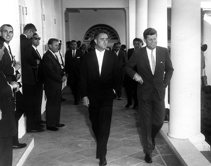 President Kennedy and Peace Corps Director R. Sargent Shriver about to greet Peace Corps Volunteers embarking to Ghana and Tanganyika.